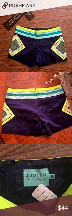 Judith Martin embellished blue colorful shorts NWT Judith March navy blue colorful embellished beaded shorts.. size Medium measurements are up above in pictures.. flat front zip up back with inside layering.. comes from a smoke Free pet free home.. beautiful shorts can be dressed up or down Judith March Shorts