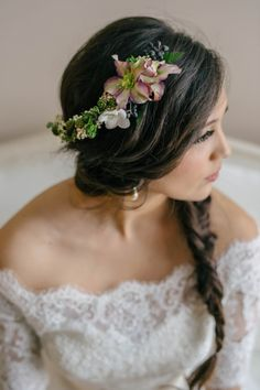 Bridal hair - fishtail braid and floral hairpiece | Photo by Amanda Dumouchelle Photography via http://junebugweddings.com/wedding-blog/what-junebug-loves/romantic-green-blue-wedding-inspiration/