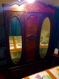 Antique 2 Mirrored Armoire in Dallas, TX (sells for $300)