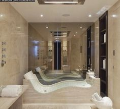 Beautiful bathroom - little steam room with chaise!