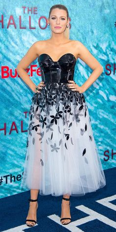 At the Shallows premiere in New York City, Lively was a vision in a black and white Carolina Herrera gown that featured abustier-style top and a sheer tulle skirt adorned with petals. from InStyle.com
