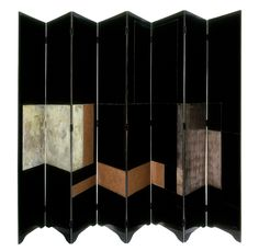 Screen, Eileen Gray, lacquer on wood, with silver leaf veneer, about 1928. Museum no. W.40:1 to 8-1977. Given by Prunella Clough
