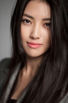 Headshot of Asian woman with eyeliner and light lip color #makeuplooksbeautiful