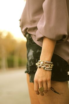Stacked bracelets, black shorts, blouse