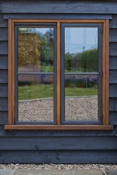 Dark wood cladding and bronze windows are a fabulous combination. windows windows windows cladding and windows Wood Cladding Exterior, House Cladding, Exterior Trim, Stained Wood Trim, Window Jamb, Workshop Architecture, Plywood Desk, Roof Trim, Weatherboard House