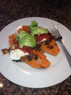 Yams with black bean stew, avocado, salsa, yogurt.  By Carolyn B.