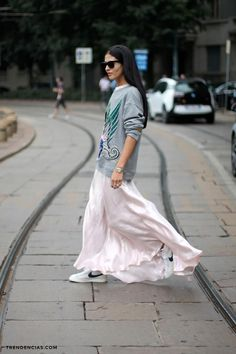 Athleisure: Silk maxi skirt, a sweatshirt and sneaks.