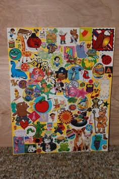 "I Spy with stickers. MAKnote: explore themes of stickers on different pages (posters), include some drawings, include some photos, always hide a favorite secret ""thing"", and..."