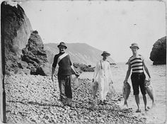 Photograph of three men holding fish caught at Cable Bay, Nelson, [ca 1900s] by National Library NZ on The Commons, via Flickr