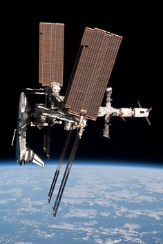 Shuttle Endeavour docked with the International Space Station. Also in the pic a pair of docked Soyuz/Progres Vehicles
