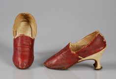 Pair of ladies slippers, Europe, 1770-1789. Red leather, white leather covered high louis heels.