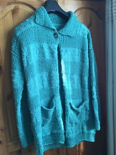 Slouchy cardigan in fisherman's rib and stocking stitch with knots