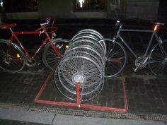 Bike wheels as bike rack - outside the Szimpla Kert ruin bar, Budapest
