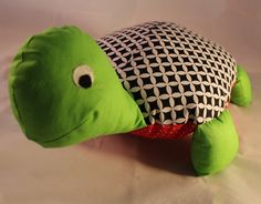 This adorable turtle cushion is a great snuggle toy. It's ideal as gift.  The little turtle will add fun and character to child's bedroom or nursery.   It can be used as a toy, decorative cushion or pillow to sleep for a child. The back side is completely smooth and comfortable for head.  Children love these pillows and spend with them all day and night.  The cushion is very delicate and soft. Made of 100% hypoallergenic materials.  You can wash it in the washing machine if it gets dirty