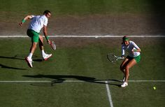 Victoria Azarenka of Belarus plays a forehand next to her partner Max Mirnyi of Belarus during their Mixed Doubles Tennis gold medal match against Laura Robson of Great Britain and Andy Murray of Great Britain on Day 9 of the London 2012 Olympic Games at the All England Lawn Tennis and Croquet Club on August 5, 2012 in London, England.