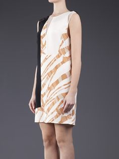 Graphic collage dress in antique white from Phillip Lim. This sleeveless silk shift dress features black, white and multicolored printed panels. Has a round neck, a sheer white inset in the front, and a sheer back yoke with keyhole and hook-eye closure. Has a short length hem, and a concealed zipper and hook-eye closure at the side