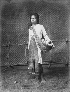 Studio portrait of a jambu bol fruit seller. 1870-1900