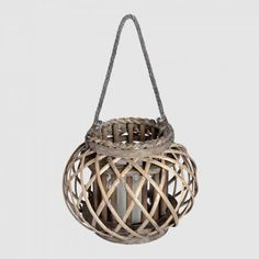 This large wicker basket lantern with rope detail and a distressed look will add style and sophistication inside or out. Made from strong natural wicker in an elegant shape, with smooth edges and a rope for hanging. #wicker #wickeraccessory #wickerlantern #homeaccent #homedisplay #homedecor Wooden Lanterns, Hanging Lanterns, Candle Lanterns, Home Interior Accessories, Decorative Accessories, Nautical Candles, Mirror Candle Plate, Tall Lamps, Hill Interiors