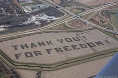 A farmer does this with his tractor. He uses GPS to get the letters readable.  He has done this every fall for several years now.    This is the view from the flight pattern into OFFUTT AIR FORCE BASE  Bellevue, NE., just south of Omaha .   This is what our servicemen see when landing at Offutt AFB.   Hat tip to the Bellevue farmer who made it happen!