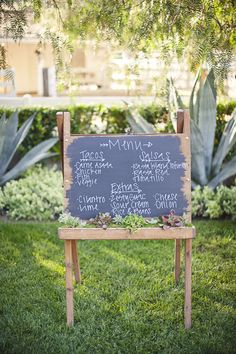 Menu or you could just use as welcome sign, love the flowers tucked away inside the chalk holder.