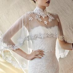 Lusan Mandongus 2017 Bridal - Hong Kong -婚紗 Elevate your bridal look with this Mao neck bolero with beaded lace details.
