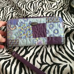 A Donna sharp wallet A beautifully designed Donna sharp wallet. In excellent condition !!!!It has a huge coin pouch it, 2 pouches to put your money in & 8 credit card holders! IM VERY NEOGOATABLE!!! donna sharp Bags Wallets