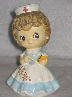 Vintage-girl-nurse-figurine-holding-medicine-bottle-spoon