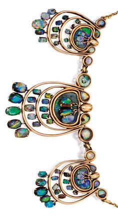 18 Karat Gold and Opal Necklace. Decorated at the front with three swirled plaques suspending fringes, set with 66 cabochon opals and three opal tablets, length 17 inches, numbered; circa 1904. With box signed Tiffany & Co. #Tiffany #ArtsCrafts #necklace