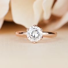 Forever One Moissanite engagement ring with lotus detail. 14k Rose Gold. Round cut. Conflict free Diamond Engagement ring alternative.
