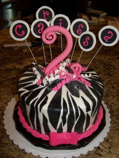 This is a chai latte cake covered in marshmellow fondant with black and hot pink fondant to decorate. The curlz lettering was done by hand....can't someone get a cutter or cricut cartridge with this font?!.