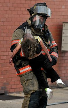 women Firefighter Rescue Images | ... Firefighters rescued two children and one adult female from the blaze