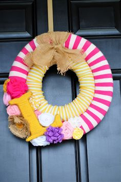 Monogramed DIY wreath from swim noodles and tights!