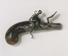 """1680 English Pocket pistol at the Victoria and Albert Museum, London - From the curators' comments: """"n late 17th- and early 18th-century England such small single-shot pistols with a flintlock mechanism (one of several types of mechanism) were carried for protection. It was designed to be carried in the pocket of a travelling coat. Like other English pistols of this type, it has no trigger guard or steel furniture on the butt (grip)."""""""