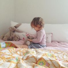 Sneaking in a play on big sister's bed (and kissing all the bunnies on the nose!)