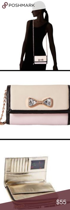 """Cross body handbag •Polyvinyl Chloride, synthetic lining, Magnetic snap closure, 23' Shoulder drop, 5.5"""" high, 7.75' wide, Color-block bag featuring decorative faux gem bow and cross- body strap. Dimensions: 8.4 X 5.6 X 2.2 inches. Betsey Johnson Bags Crossbody Bags"""