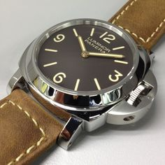 Panerai Pam 390 Special Edition Brown Dial Luminor Base with Gold Hands $7400 on eBay.  Classic 44mm Luminor with a brown dial.  Cool.
