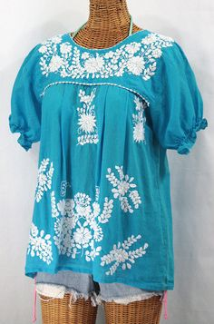 """Siren's Mexican Peasant Blouse Top Hand Embroidered: """"La Mariposa"""" Turquoise. $44.95, via Etsy, or visit SirenSirenSiren.com."""