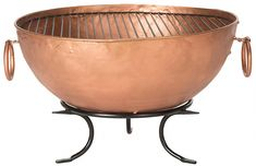 A classic old world vessel shape in black and copper iron. the Bangkok fire pit inspires fireside chats that light up a backyard party in style. With ring handles and pedestal base contrasting its copper tub. this wood burning pit will blaze for hours. Chiminea Fire Pit, Fire Pit Backyard, Fire Pits, Bangkok, Fire Pit Party, Copper Tub, Modern Fire Pit, Wood Burning Fire Pit, Fire Pit Designs