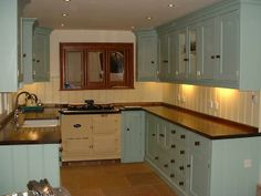Small kitchen... duck egg cabinets and cream Aga
