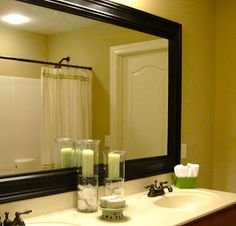 """Impatiently Praying for Patience: Great tutorial on how to put trim around the giant and boring """"builder's mirror"""" in the bathroom."""