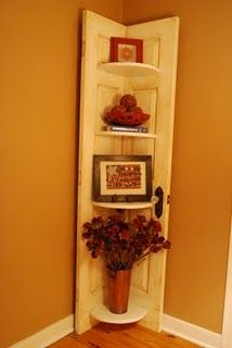 Old door, cut in half, and then reassembled as a corner shelf... AMAZING!!!!