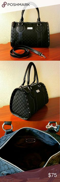49✂Nine West Black Satchel Bag ✨NWT, but not attached Got torn off when I was taking picture   ⏩Sized right for daily essentials, this stunning bag features deep, luxuriously rich black color & silvertone hardware ⏩Polished Nine West plaque & signature jacquard ⏩Dazzling studs around the sides ⏩Interior➖fully lined,1 zip pocket,2 slip pockets ⏩Zipper top closure,dual handles ⏩DETACHABLE strap ⏩Can be carried by the handle, slung on a shoulder, or worn hands-free using the strap  Size(apx)…