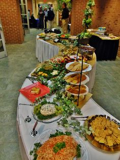 Finger food buffet on spiral shaped tables for a special birthday party!