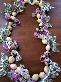 Money lei with leopard and pink ribbons