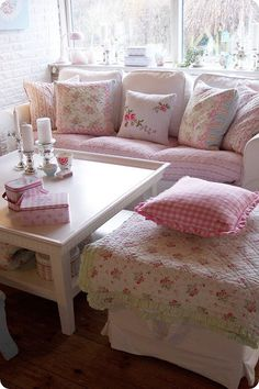 Shabby chic pink & white sunroom decor--bright & cheerful--cozy & comfy with all those pillows!