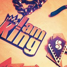 """I am King"" custom acrylic pendant."