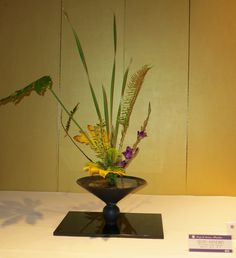 When displaying ikebana or anything for that matter, remember that the background makes a huge difference.  This gold screen really enhances the flowers.