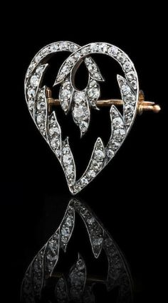 Fedor Afanas'ev - A Belle Epoque gold and diamond brooch, St. Petersburg, circa 1911. Of heart-shaped form, with two foliate branches forming a loop on top, set with old-cut diamonds, 56 standard. Height: 3.2cm.