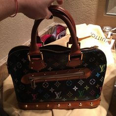 Louis Vuitton alma multi color Amazing piece was loved by me !! Louis Vuitton alma multi color !! 12.6 x 9.4 x 5.9 inches  - black multi color  - Wide opening for easy access . - Interior patch and phone pockets - Soft Microfibre lining - Protective bottom studs Louis Vuitton Bags Satchels