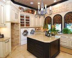 laundry room deluxe....I might not mind doing laundry if mine looked like this!!! lol